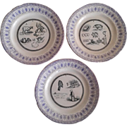 19th century  French « Choisy- le Roi » faience :a set of 3 dessert plates with rebus .
