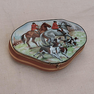 A vintage French Limoges porcelain box with hunting decor.