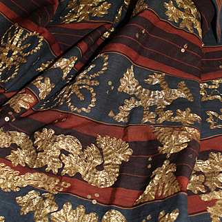 Large ethnic old panel embroidered with golden threads and sequins.