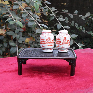 A set of Far East miniatures for dollhouse:2 porcelain vases and a bronze table.