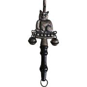 Amusing French vintage cat-shaped metal rattle with bells and whistle .