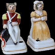 Circa 1900: Rare and original pair of German porcelain inkwells «Marechal Cat and Madam»…