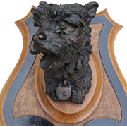 France late 19th century: Beautiful dog's head « Terrier « in brown patina metal on a wooden escutcheon,from Prosper Lecourtier.