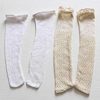 Two pairs of French vintage stockings in fine openwork cotton,for fashion dolls.
