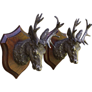 Set of two beautiful  metal deers' heads on wooden escutcheons.France,early 20th century.