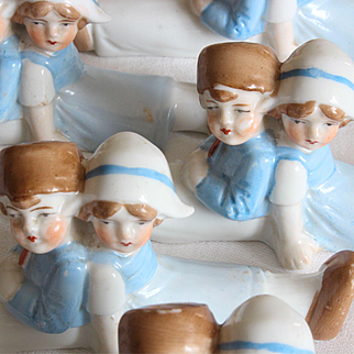 Set of 5 charming German porcelain knife rests with a little Dutch children shape.Circa 1900-1920.