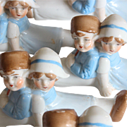 Reserved for Carolyn U.Set of 5 charming German porcelain knife rests with a little Dutch children shape.Circa 1900-1920.