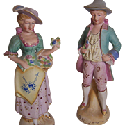 Pair of Bisque Man and Woman Figurines