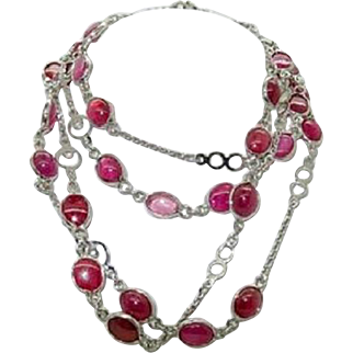 Sterling Silver and Ruby Necklace in 39 inch length and weighs 33 grams with 66 carats total weight