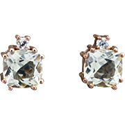 14K Rose Gold, Green Amethyst, and Topaz pierced post Earrings weighing 3.5 grams.