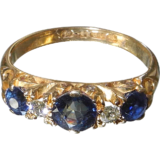 Early 20th Century hallmarked 18 karat gold traditional scroll set sapphire and diamond ring