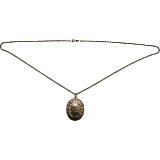 Early 20th Century testing as 9 karat gold engraved locket and chain