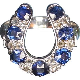 Mid 20th Century 18 karat white gold, diamond and sapphire horse shoe ring