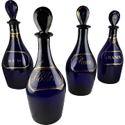 Rare Group of Four Cobalt Bristol Glass Bottles: Rum, Hollands, Brandy and Rum - 18th Century Blown Liquor Containers