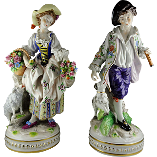 Pair of Antique Sitzendorf Porcelain Figurines Germany - Woman w/ Sheep Carrying Flowers & Man with Flute and Dog