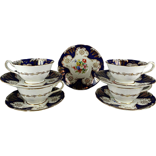 4 Hand Painted Cobalt and Gold Floral Center Cup and Saucer Sets
