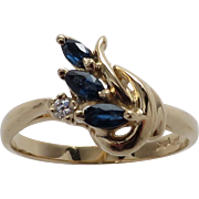 Gorgeous Marquise Cut Sapphire and Diamond Swirl Ring