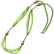 1970s Very long necklace multistrand green glass and goldtone metal beads