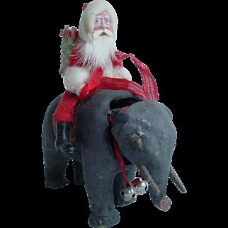 Old Japan or Germany Santa Claus on Elephant Nodder