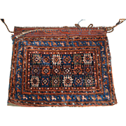 Antique South West Persian tribal saddle bag with plain weave back. Possibly Afshar Tribe. Circa 1900.
