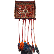 Antique South West Persian tribal chanteh (vanity bag) with plain weave back and tassels, by the Qashqai Tribe.  Circa 1900