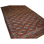 Antique Yomut Turkmen main carpet with the 'Dyrnak' gul design and large eagles in the elem.  Late 19th century.