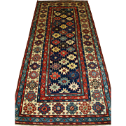 Outstanding Antique Caucasian Talish long rug with all over star design.  Mid 19th century.