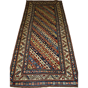 Antique Caucasian Gendje Kazak long rug with stripe design and superb colours.  2nd half 19th century.