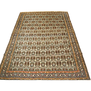 Antique Isfahan rug with an interesting all over repeat design of a vase of flowers with Cyprus trees on either side, all framed within a fine lattice.   Circa 1910.