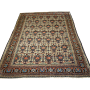 Antique Abedeh rug with the classic 'vase and peacock' design, having excellent soft colours on an ivory ground.   Circa 1900.