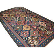Antique Varamin kilim with excellent natural colours and outstanding bold graphic design.   Circa 1900.