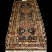 Antique Kurdish long rug with linked medallion design.  Circa 1900