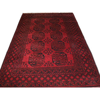 Old Afghan village rug of traditional design with two rows of five large guls.   About 60 years old.