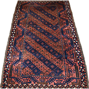 Antique Persian Baluch rug with diamond lattice design from Eastern Persia.  Great condition.  Circa 1900.