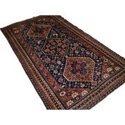 A very good Antique Tribal Qashqai rug, very fine weave with three medallions.   Circa 1900.