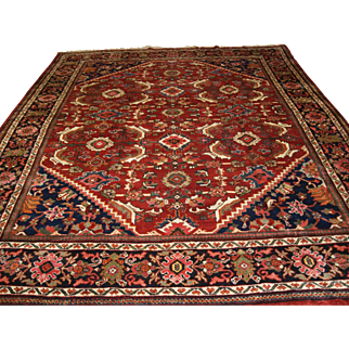 Old Persian Mahal carpet of good size with a traditional all over design.   Circa 1920.