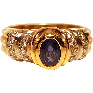 Nice Italian 18 K. Gold Ring with an Oval Sapphire & Brilliants