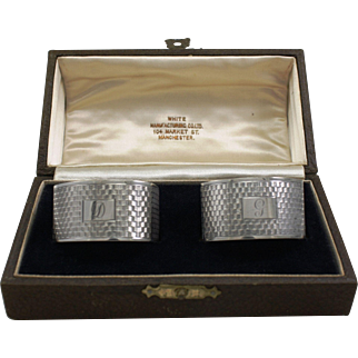 A boxed pair of English Sterling Silver napkin rings