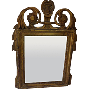 French 18th Century carved and gilded mirror
