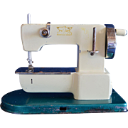 Green Cream Toy Sewing Machine