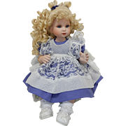 Limited Edition Bisque doll; Gorgeous Blond curled beauty; blue pinafore, wnder dress and white open lace apron