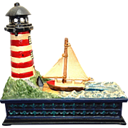c.1980 Mechanical SAIL BOAT & LIGHT HOUSE  cast iron Reproduction coin Bank, Working condition