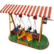 Carnival  Tin Wind Up Toy;  Made in Germany ; Swinging Canoes  with four riders, extremely nice condition