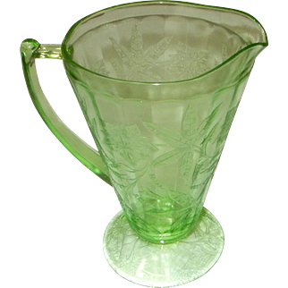 Green depression glass pitcher Floral Poinsetta pattern 7.5 by 7 inches
