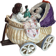 Large Antique Staffordshire Fairing Box Depicting Girl, Doll and Baby in Pram