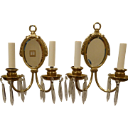 Pair of E.F Caldwell Brass Double Arm Mirror Back Sconces with Crystals circa 1920's-30's