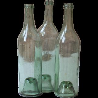 Three Antique Green Glass Burgundy Bottles