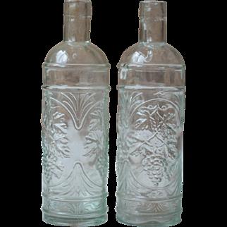 Pair of Art Nouveau Clear Glass Bottles