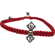 Sterling silver Dorje charm with red hand braided adjustable bracelet