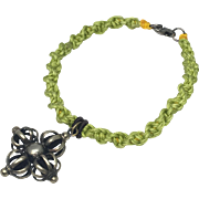 Sterling silver Dorje charm with lime green color hand braided bracelet with silver clasp